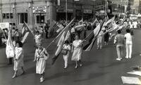 Women walking with flags