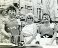 Women on a parade float