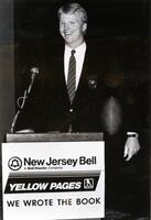 Representative from New Jersey Bell giving a speech at Yellow Pages podium