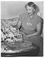 Effa Manley reviews her scrapbook