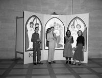 Lobby Board of Ed. Building, 4 West Side High School (Newark, N.J.)Students Standing before Panels Miss M. Grace Johnston, Art Department