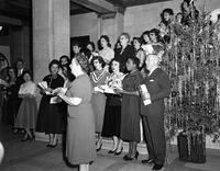 Board of Ed Building Carol Singing Miss Murphy in Foreground Miss Agnes Murphy's Department